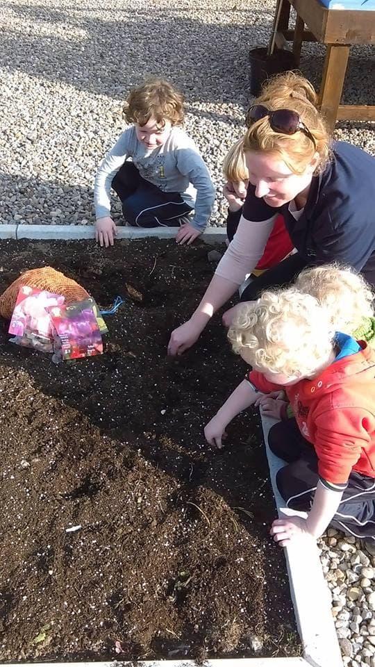 Kids planting bulbs at Rockbarton Garden Centre